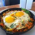 Sunnyside Up Eggs Over a Sweet Potato Hash